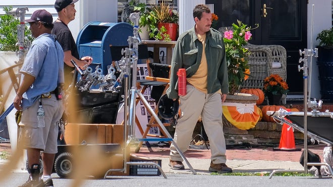 Adam Sandler walks towards the set during the filming of Adam Sandler´s Netfilx movie Hubie Halloween on Washington Street in Marblehead on Monday, July 15, 2019. Casting director Judith Bouley said she's casting in the Boston area for a Netflix production to be filmed on the South Shore between mid-November and February.