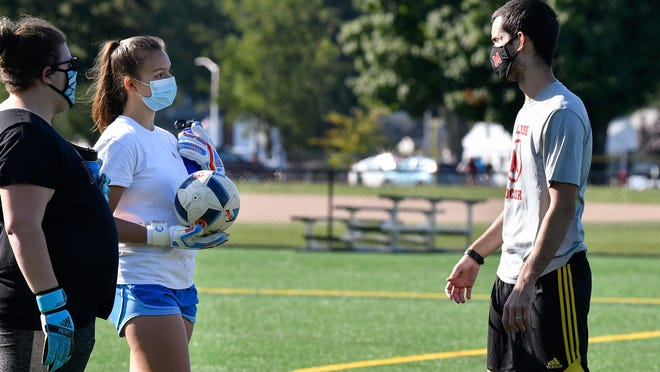 Goalkeepers Sydney Medina and Ava Tormo talk with Melrose varsity girls soccer coach Rob Mahoney during a team practice at Pine Banks Park on Monday, Sept. 21.