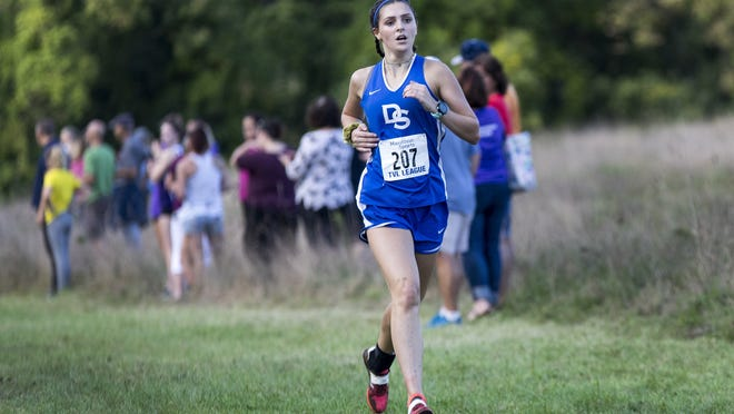 Dover-Sherborn's Caitlin Britt, pictured as a sophomore, finished first on Sunday as a senior in race against Westwood.