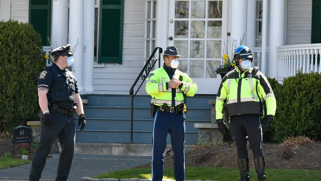 Boston protester has been ordered to stay 100 yards away from Massachusetts first lady Lauren Baker after allegedly placing used hypodermic needles outside the family's house on Monument Avenue.