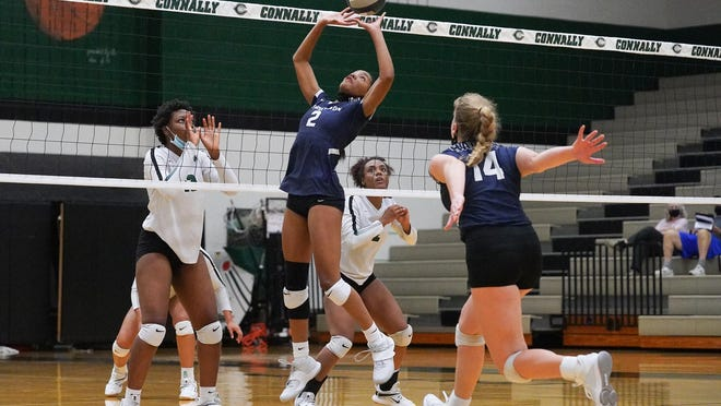Hendrickson's Karys Dove sets the ball against the Connally Cougars Thursday at Connally High School. The Hawks beat Connally in four sets to move within one win of the District 18-5A title.