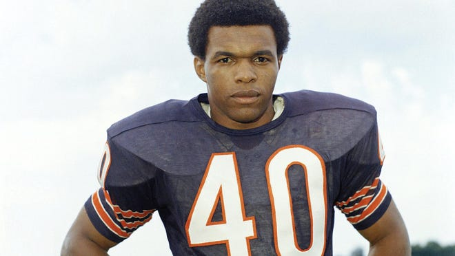 "Chicago Bears running back Gale Sayers poses for a photo in 1970. The Hall of Famer made his mark as one of the NFL's best all-purpose running backs, was nicknamed ""The Kansas Comet"" and considered among the best open-field runners the game has ever seen. Sayers died Wednesday, according to the Pro Football Hall of Fame."