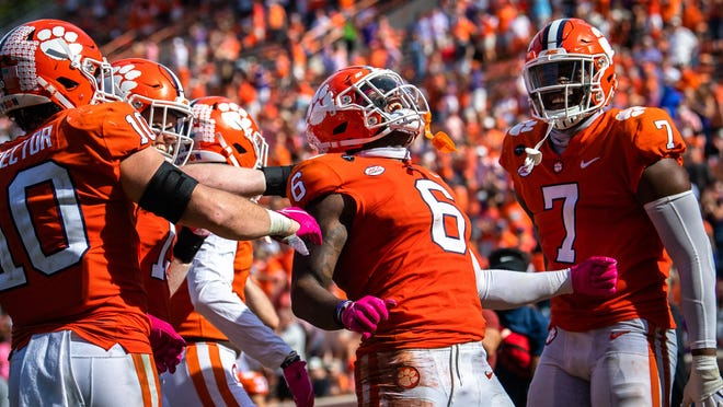 Clemson linebacker Mike Jones Jr. (6) celebrates an interception during last week's win over Syracuse. The Tigers have allowed just 13.5 points per game this season and they're third in the nation in total forced turnovers (13).