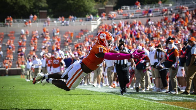 Clemson wide receiver Cornell Powell (17) dives into the end zone for a touchdown during an NCAA college football game against Syracuse in Clemson, S.C., on Saturday, Oct. 24, 2020.