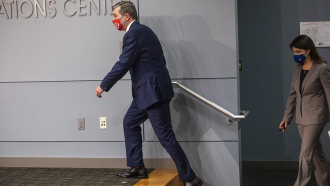 Gov. Roy Cooper walks to the lectern before speaking at a briefing on the state's coronavirus pandemic response Tuesday at the N.C. Emergency Operations Center in Raleigh.