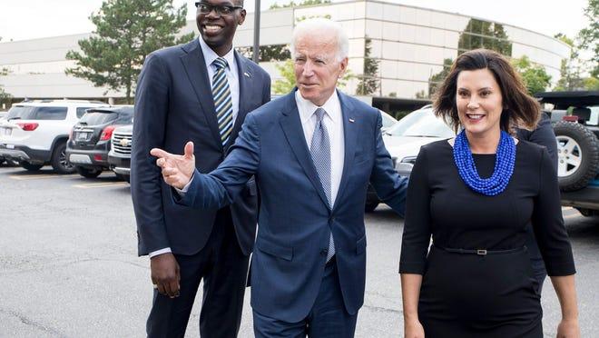 Democratic gubernatorial running mate Garlin Gilchrist, former Vice President Joe Biden and Democratic gubernatorial candidate Gretchen Whitmer arrive at Leo's Coney Island in Southfield, Mich., Wednesday, September 12, 2018.