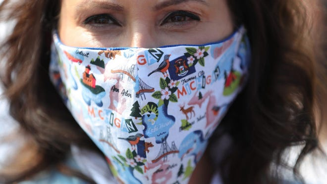 Gov. Gretchen Whitmer wears a decorated mask during a march with faith leaders against police brutality Thursday, June 4, 2020, in Detroit. Whitmer said Monday that a statewide mask requirement remains in effect despite the Michigan Supreme Court's invalidation of a law that underpins her orders to control the coronavirus pandemic.