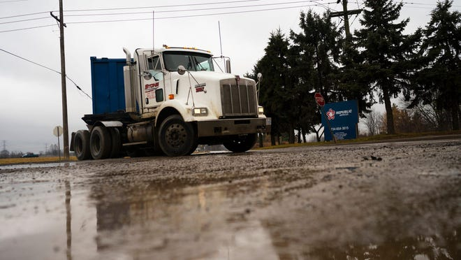 A truck enters the Carleton Farms Landfill on Dec. 30, 2020, in New Boston, Mich.