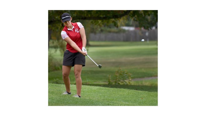 New Boston Huron's Andie Martin chips to the second hole green during the Monroe County Championship in late September at Monroe Golf & County Club.