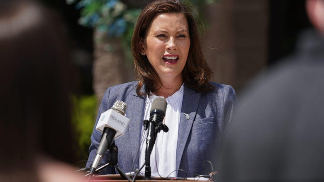 Michigan Governor Gretchen Whitmer speaks to press outside of Meridian Elementary School in Sanford while giving an update on state's response to emergency from dam conditions in Midland County on Wednesday, May 27, 2020.
