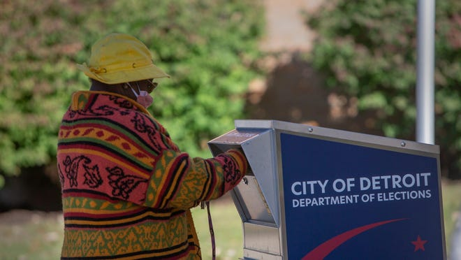 Dorothy Virgil, 78, of Detroit, drops her ballot off as early voting is taking place at a variety of satellite locations around Detroit including the Northwest Activities Center on Meyer Rd. in Detroit on Oct. 5, 2020.