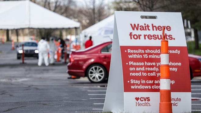 CVS Health opened its first coronavirus rapid-testing location at Henry Ford Centennial Library in Dearborn on Tuesday, April 21, 2020. Using the Abbott ID NOW COVID-19 tests, the drive-up site will offer results on the spot at no cost to customers.