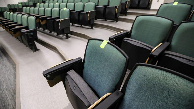 Seats in a lecture hall at Eastern Michigan University in Ypsilanti are marked with green tape to encourage social distancing. More than 200 professors have signed an open letter to Gov. Gretchen Whitmer asking her to order Michigan colleges and universities to teach most classes online only.