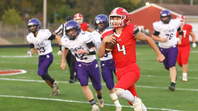 Simon Vinson breaks free for a huge gain against Athens in prep football action on Friday night.
