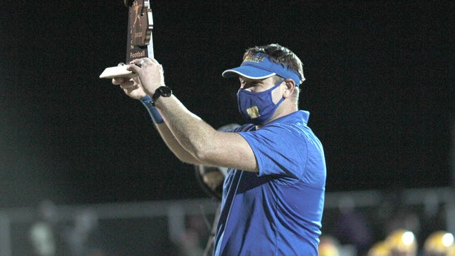 Centreville head coach Jerry Schultz holds up the district trophy after the Bulldogs knocked off No. 1 Reading in the district finals back in November. The MHSAA representative council is meeting on Friday to discuss potential updates and plans to finalize fall sports and the future of winter sports.