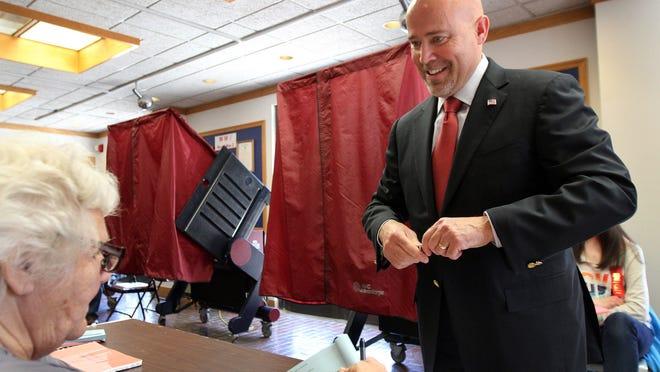 Tom MacArthur votes in Toms River.