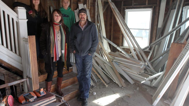 Mike Irwin, Krista Sperber and their family stand inside their 8th Avenue home in Belmar.