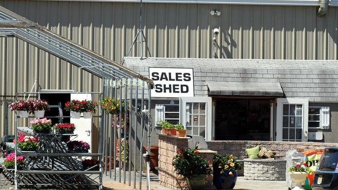 Stephen's Garden Center in Long Branch, accused of price gouging for generators after superstorm Sandy, will pay $33,000 to settle the case.