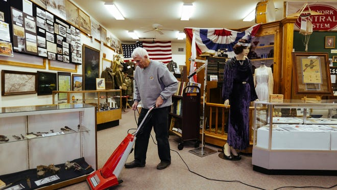 """I think we're doing a real service even if nobody comes in here. The fact that we're saving this information and saving artifacts is very important,"" Keith Martin, curator of the Galesburg Historical Museum, said while vacuuming the empty museum on Wednesday, Dec. 17, 2014."