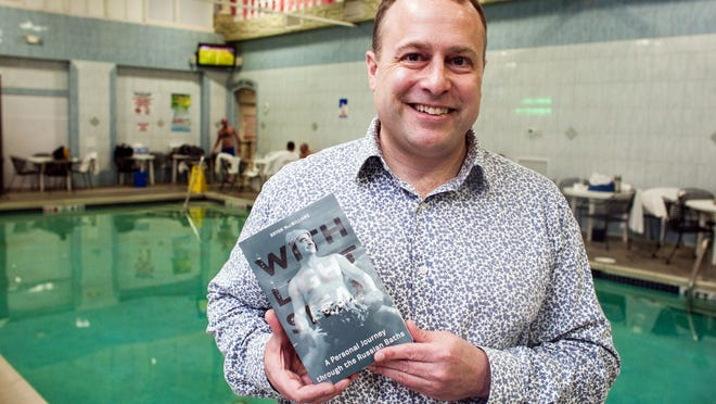 Bryon MacWilliams shows a copy of his new book at Southampton Spa in Pennsylvania, where he frequently creates steam for spa guests.