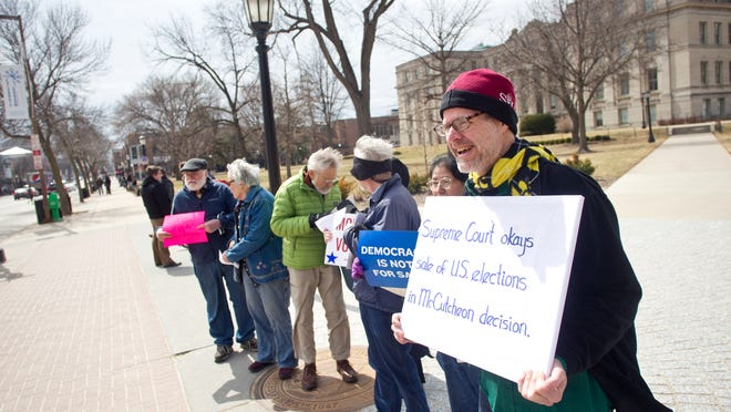 Douglas Narvseon, right, joined his peers on the UI Pentacrest to protest the ruling by the U.S. Supreme Court in Iowa City, IA on Wednesday, April 2, 2014.