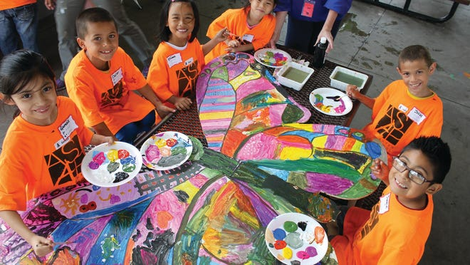Students with the After School Arts Program painted a butterfly mural this summer at Evelyn K. Davis Park.