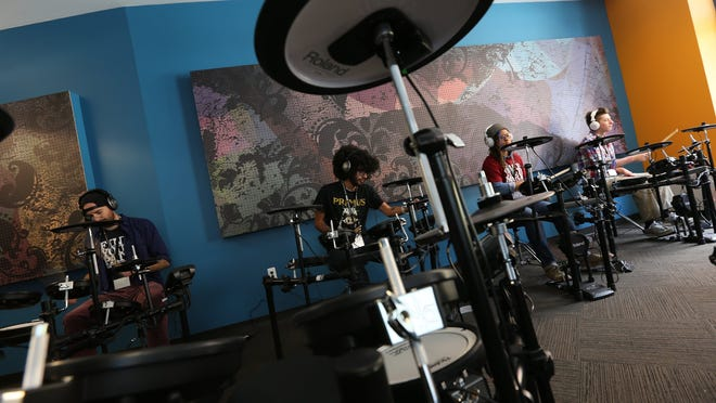 """Students practice on the electronic drums at the Detroit Institute of Music Education known as DIME officially opened its doors this summer in """"The new DIME building in Detroit. Tuesday, September 16, 2014. they hosted an open house as they are about to start the their first college level courses on September 22."""