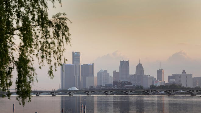 The sun sets on the Detroit skyline viewed from Belle Isle in Detroit on Wednesday June 4, 2014.