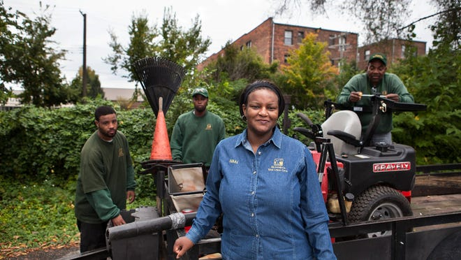 Alexander's Total Lawn Care, Front: Owner, Angela Alexander; rear, left: James Little, Thomas Johnson, Ray Cleveland.