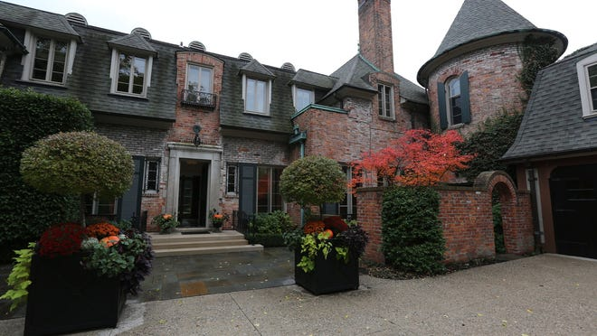 This lovely French Normandy-style home is infused with color by interior designer Kathleen McGovern, who gives this 1925 French Colonial home a modern yet European feel and old-world craftsmanship in Grosse Pointe. The grounds are well maintained with a pool and a carriage house and 3 car garage. On 7,629 square feet, this home has 6 bedrooms, 7 baths a total of 14 rooms listed for $1,775,000