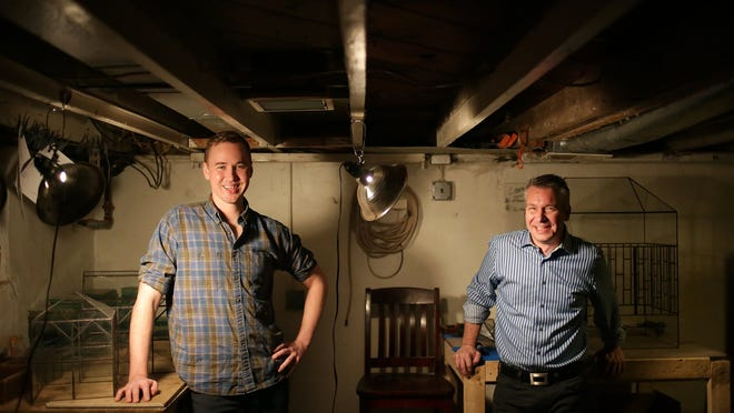 Chad Ackley, left, and his partner Derek Smiertka, both of Ferndale started Leadhead Glass last year in the basement of their home.  They were photographed in their work studio on Wednesday, Nov. 5, 2014.