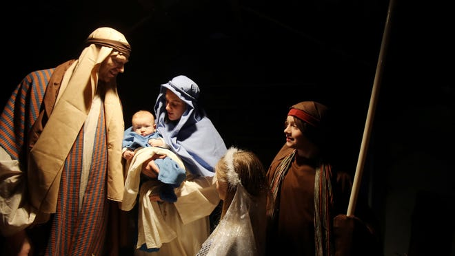 Baby Jesus, played by 3-month-old James Childs, surveys the action around him at the Detroit First Church of the Nazarene in Northville. The scene was a family affair: James is with parents Mark and Jackie (Joseph and Mary) and siblings Therese, 5, and John, 8.