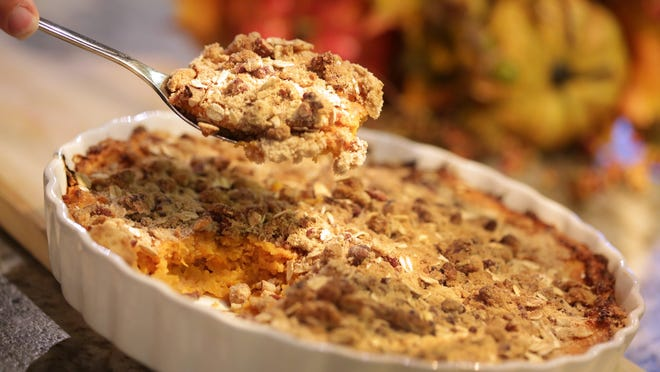 Our healthy spin on this holiday classic of Sweet Potato Casserole with Pecan Crumble, photographed at the Great Lakes Culinary Center in Southfield, relies on reduced-fat cream cheese and evaporated fat-free milk instead of butter for creaminess.