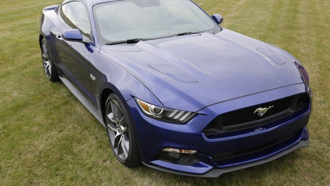 The 2015 Ford Mustang GT sports a six-speed manual transmission and 5.0L V8 that produces 435 hp. Prices for GTs start at $32,100.