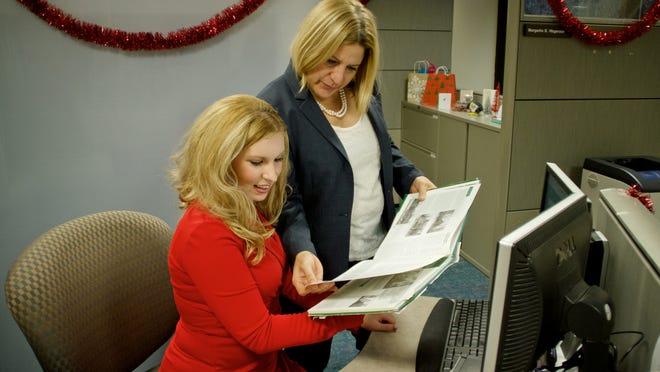 Miranda Mayuiers of Troy, left, a social media consultant, confers with Margarita Bauza Wagerson of Ferndale, manager of marketing and communications at Oakland Community College in Bloomfield Hills.