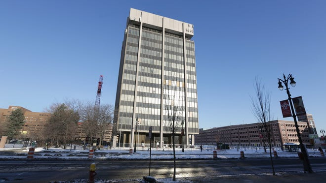 The Professional Plaza building, 3800 Woodward, in Midtown Detroit is being redeveloped. It is also known as the Hammer and Nail building for the iconic neon sign atop the building.