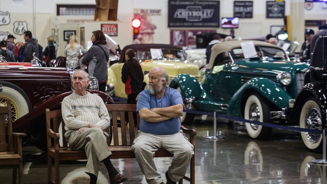 Phil Lang, left, of Warren and Mike Zawacki of Clinton Township take a break from browsing the private collection of automobiles at Stahls Automotive Foundation in Chesterfield Township on Nov. 25, 2014. There is no charge to enter, and volunteers are eager to answer questions and explain automotive innovations.