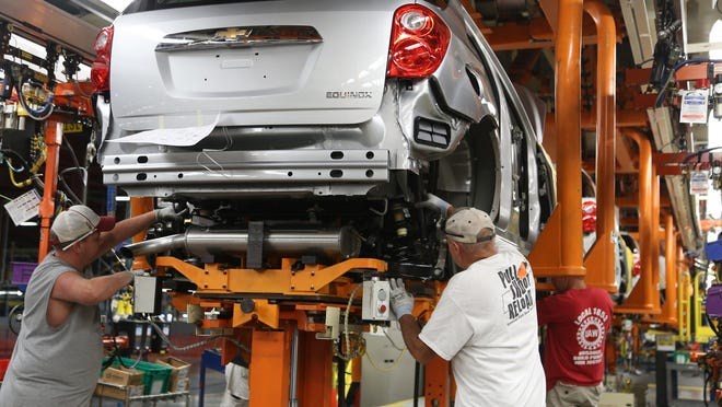 Workers  assemble a Chevrolet Equinox last August at the General Motors Spring Hill manufacturing complex. Production stopped Monday afternoon at Spring Hill and Bowling Green, Ky., due to winter storm Octavia.