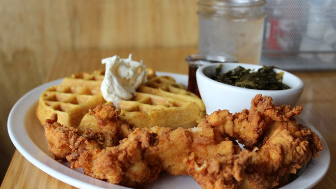 The Sweet Daddy — chicken tenders and a sweet potato waffle — with a side of collard greens at Kuzzo's Chicken & Waffles