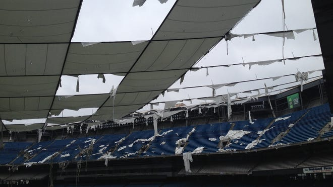 In May 2014, sections were missing from the inflated roof of the Pontiac Silverdome, but that roof is gone now and the inside is snow covered.