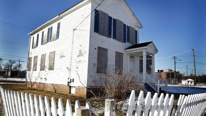 Getting the house to its new location is only one challenge. Paint is flaking, and the windows are boarded up.