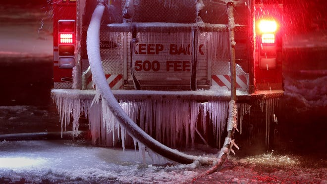Ice covers the back of Engine 41 at a Detroit fire. Frozen fire hydrants cause worse problems. At one Detroit house fire, firefighters had to go an extra block-and-a-half north and south of the blaze to find working hydrants.