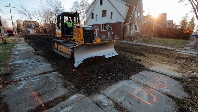 Adamo Demolition workers on Elmdale Street on Detroit's east side.