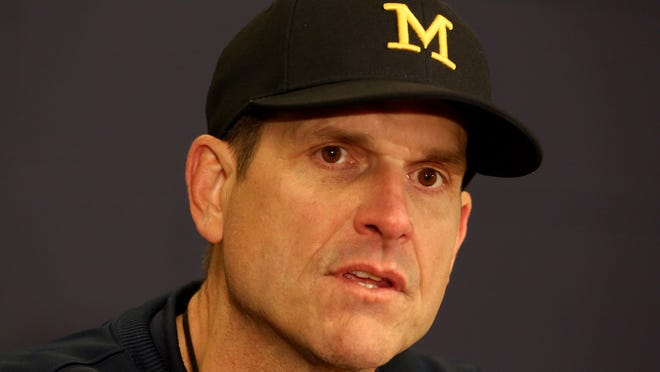 Michigan head football coach Jim Harbaugh talks to the media after the annual spring football game at Michigan Stadium in Ann Arbor, Michigan on Saturday, April 4, 2015. The practice which was open to the public who came to see the new look Michigan football under Harbaugh who returns to coach his alma mater. The Blue team beat the Maize team 7-0.
