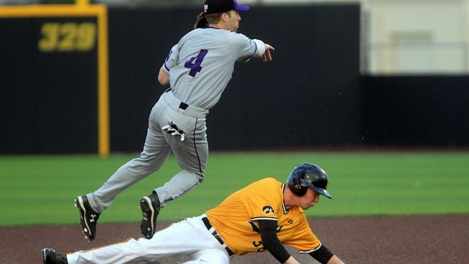 Iowa's Tyler Peyton gets tagged out at second plate during the Hawkeyes' game against Northwestern at Duane Banks Field on Friday, April 17, 2015. David Scrivner / Iowa City Press-Citizen
