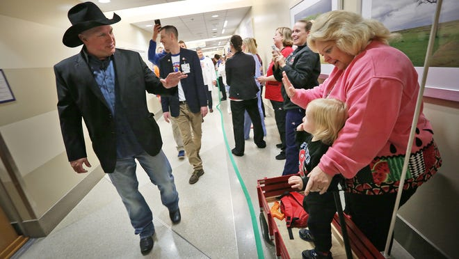 Country music star Garth Brooks leads a parade through the halls of Riley Hospital for Children at IU Health for the inauguration of the new Child Life Zone. The halls were lined with Riley Kids, family and staff Tuesday, April 7, 2015.