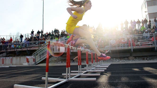 West High's Valerie Welch leaps over a hurdle during the 4x100 meter shuttle hurdle race at the Forwald Coleman Relays at City High on Thursday, April 17, 2014. David Scrivner / Iowa City Press-Citizen