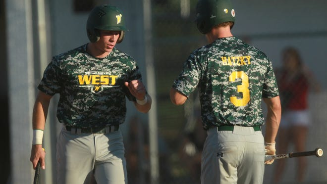 West High's Brock Hatzky, right, congratulates Devin Raffensperger after he scored during their game against City High on Tuesday at Mercer Park.