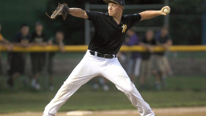 Regina pitcher Jake Brinkman throws a pitch during the Regals' game against West High on June 17 at Regina.