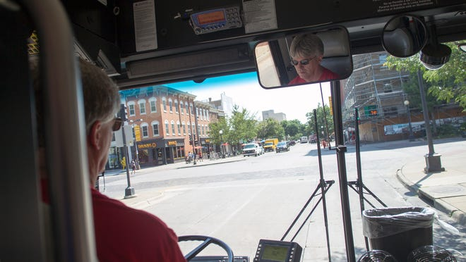 Carl Nelson drives passengers through Iowa City on the route to Sycamore Mall on Friday. Nelson took second place in this year's Iowa Public Transit Association Roadeo competition.